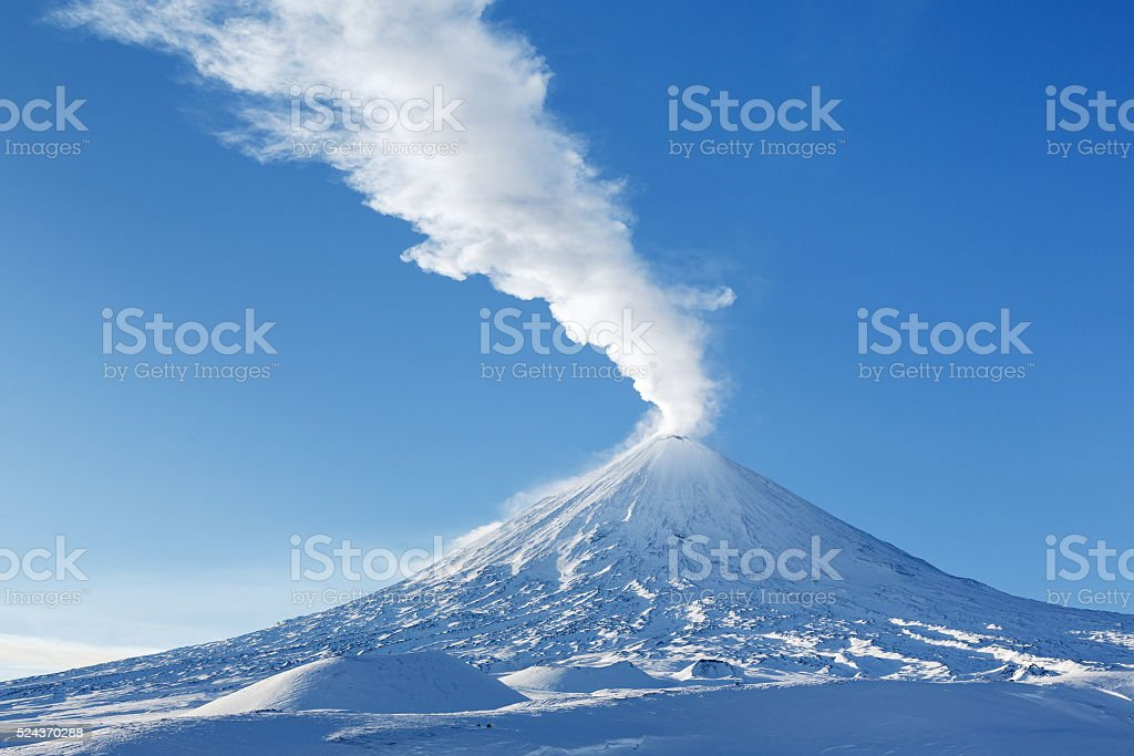 Winter view on eruption Klyuchevskaya Sopka - active volcano Kamchatka stock photo