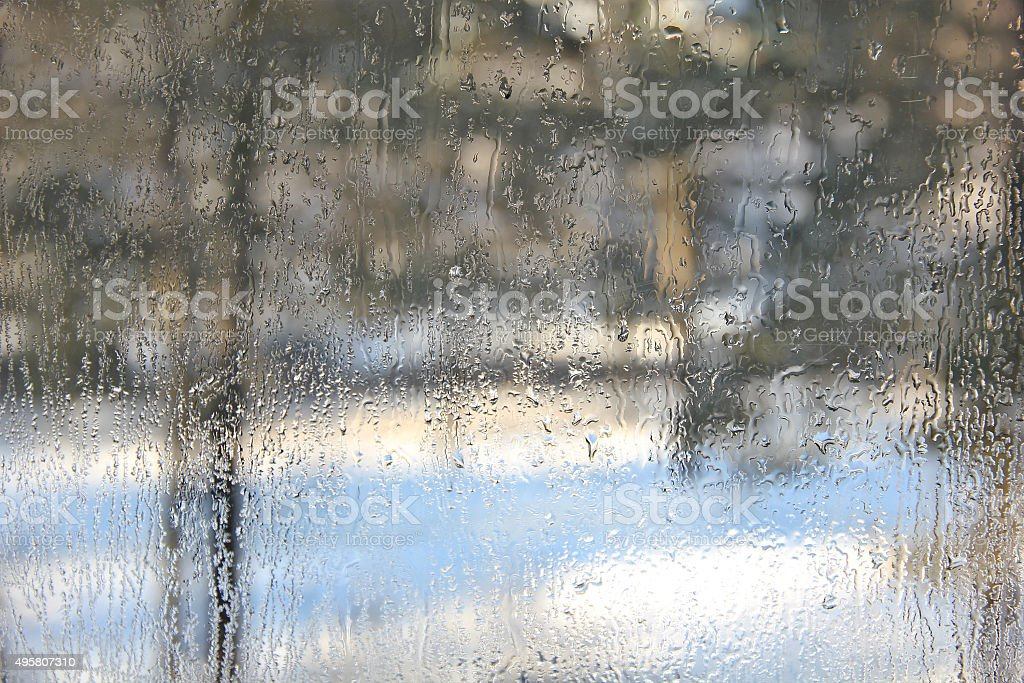 Winter view through misted over glass of window. stock photo