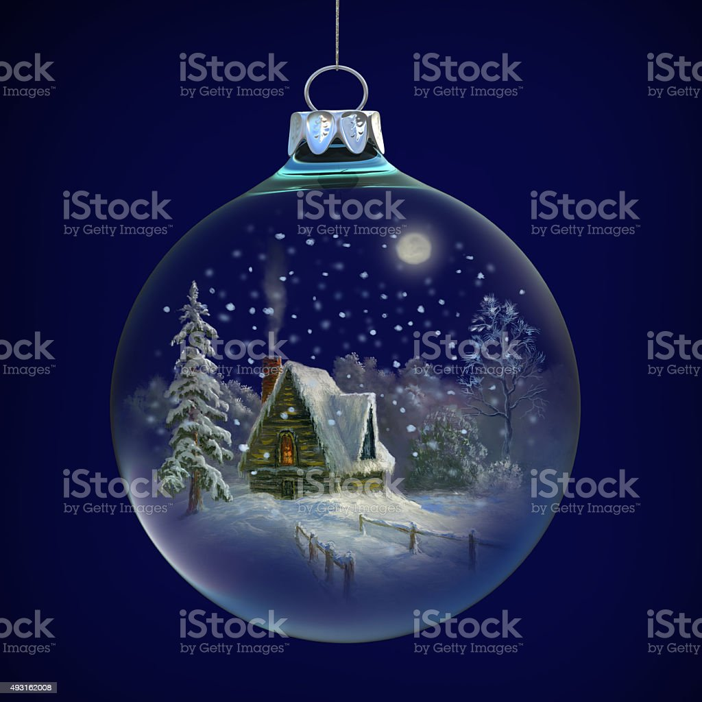 winter village in glass ball stock photo