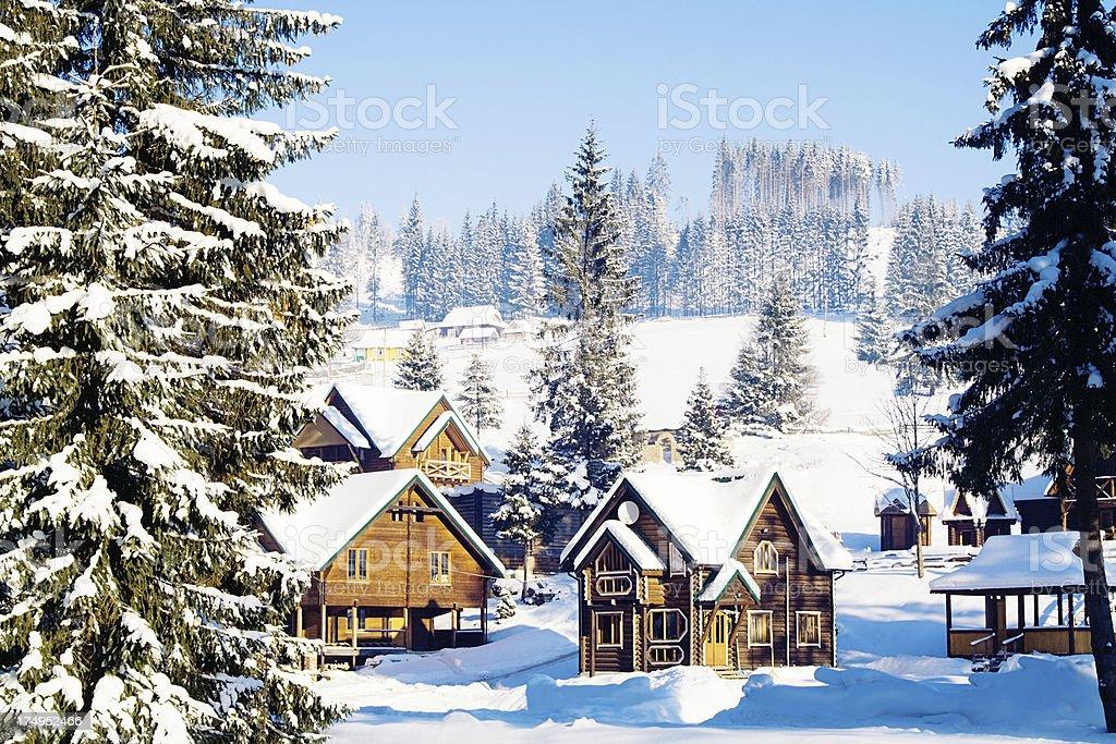 Winter village in mountains stock photo
