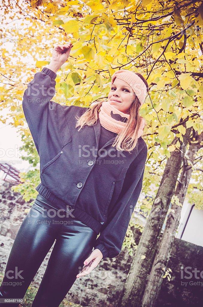 Winter walk, brunette beauty in black stock photo