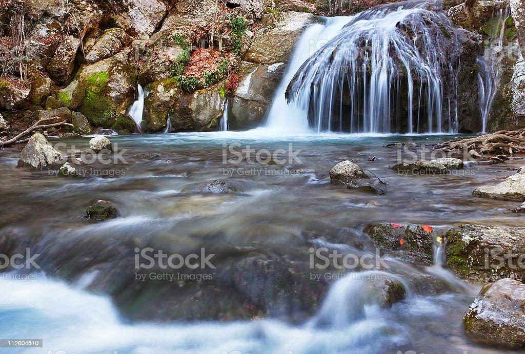 Winter waterfalls in mountains. stock photo