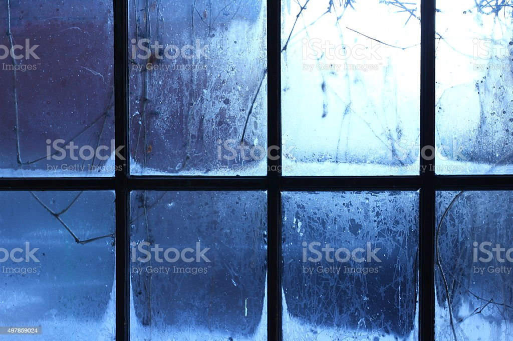 Winter window, drops of water and snowflakes on a window pane. stock photo