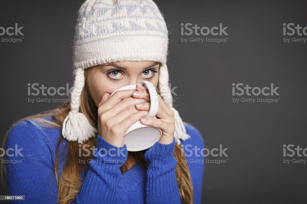 Winter woman drinking tea royalty-free stock photo