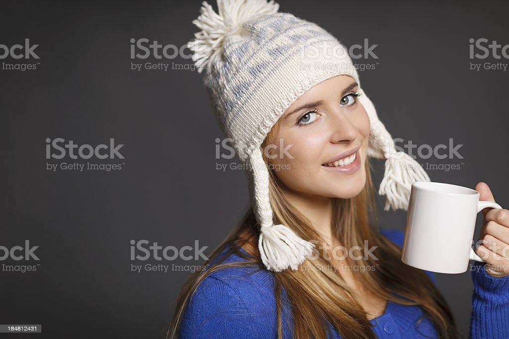 Winter woman holding white tea cup royalty-free stock photo