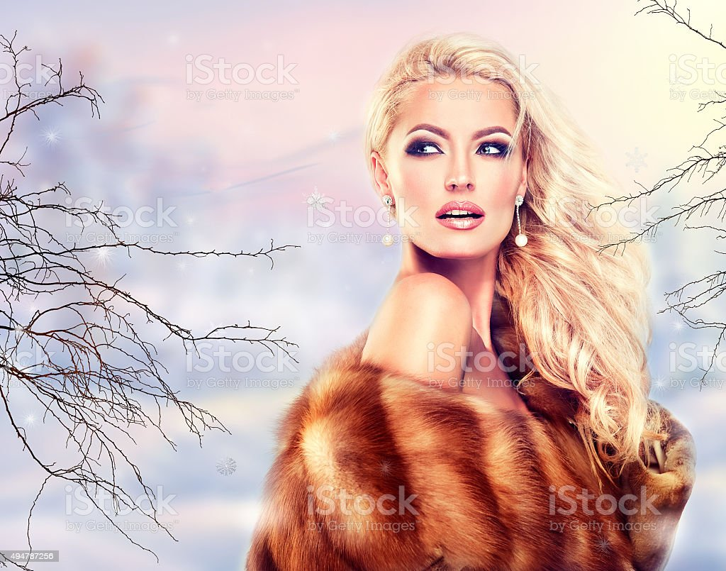 Winter Woman in Luxury Fur. stock photo