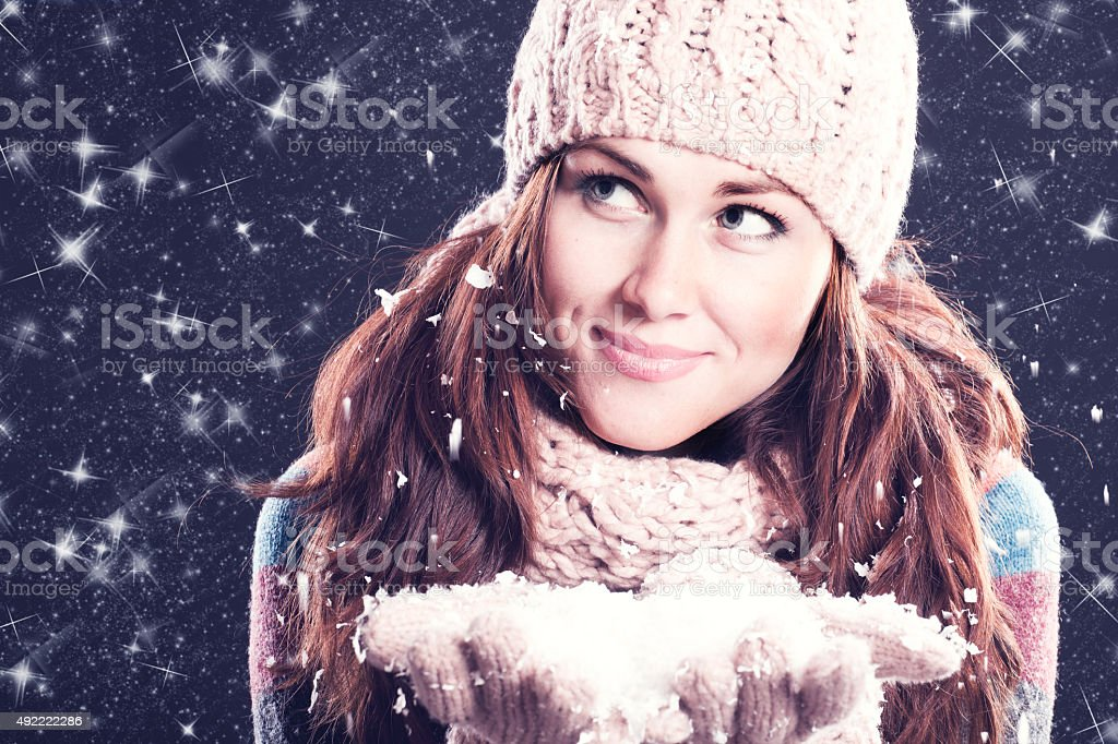 Winter woman looking up stock photo