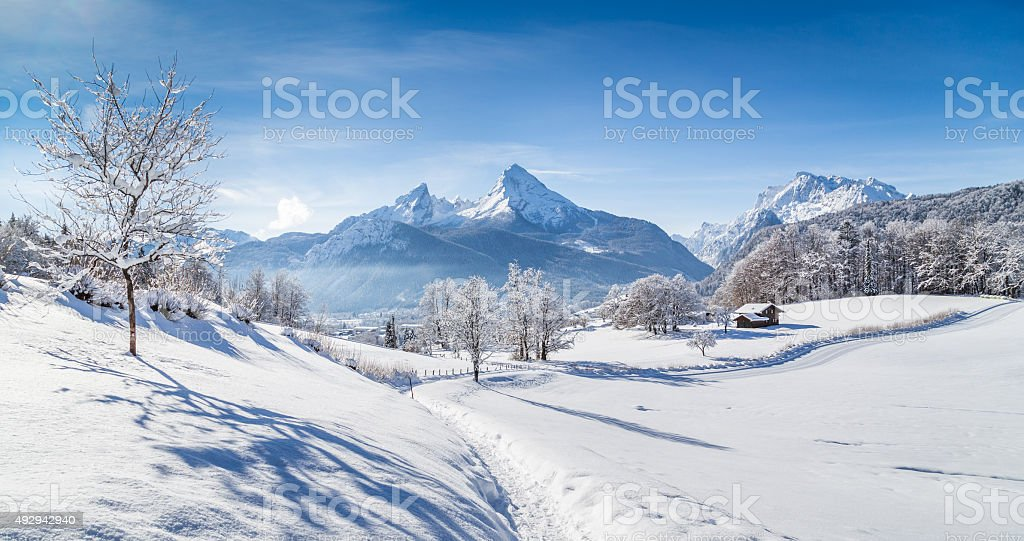Winter wonderland scenery with hiking trail in the Alps stock photo