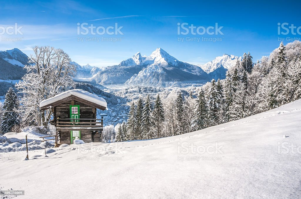 Winter wonderland scenery with mountain chalet in the Alps stock photo