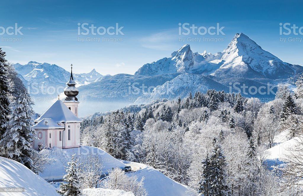 Winter wonderland with chapel in the Alps stock photo