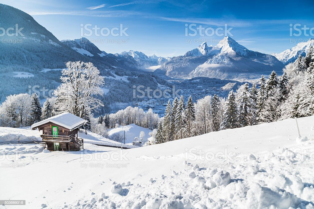 Winter wonderland with mountain chalet in the Alps stock photo