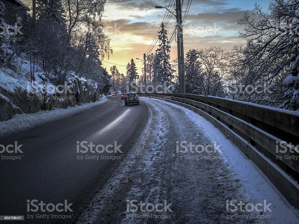 winter wounderland with a road a cars and trees stock photo
