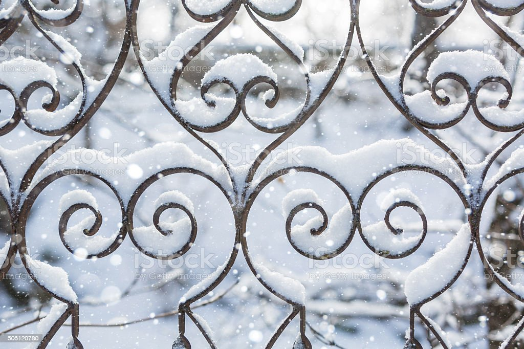 Winter wrought fence pattern stock photo