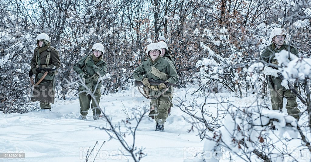 Winter WWII US Army Soldier Platoon Searching For Enemy stock photo