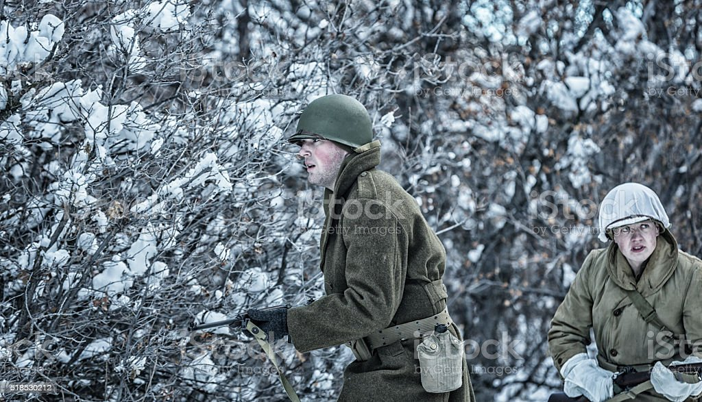 Winter WWII US Army Soldiers Searching For Enemy stock photo