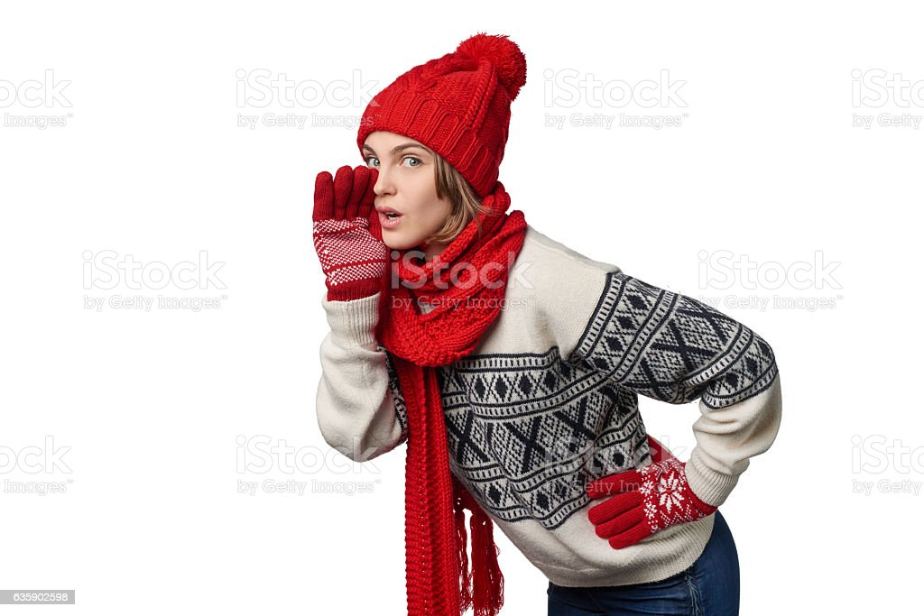 Winter Xmas girl telling a secret stock photo