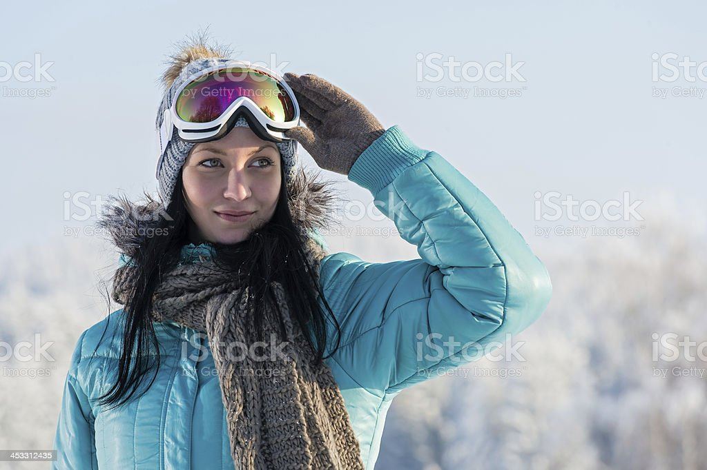Winter young woman with ski goggles snow stock photo