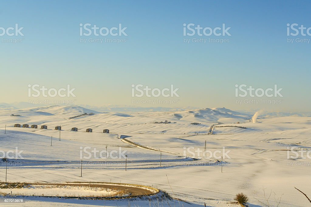 RURAL LANDSCAPE WINTER.Between Apulia and Basilicata:snowy hills landscape .-ITALY- . stock photo