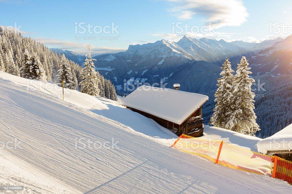 Winterlanschaft mit Schihütte stock photo