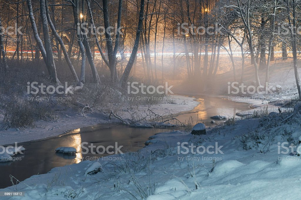 Winter-time fog over brook by night stock photo