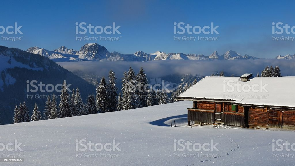 Wintery landscape and old timber hut near Gstaad stock photo