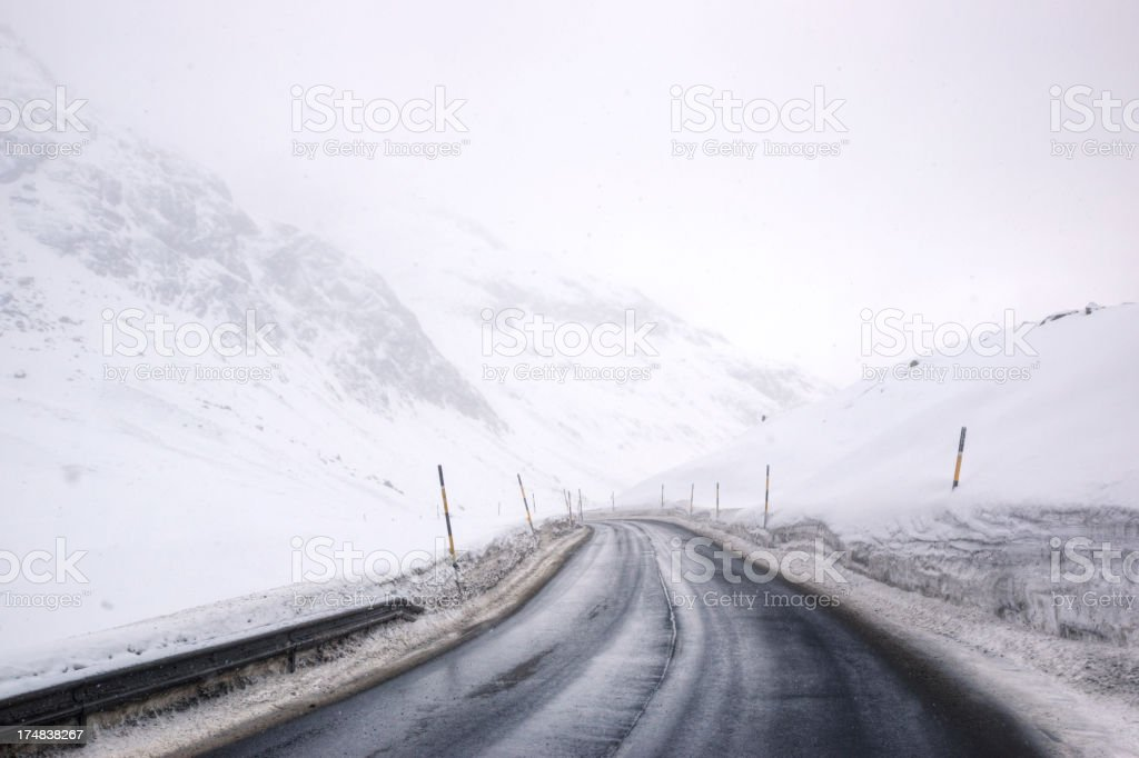 Wintry Mountain Road High in the Swiss Alps stock photo