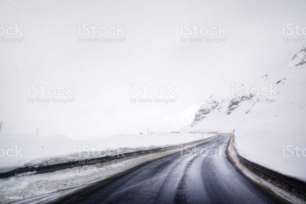 Wintry Mountain Road High in the Swiss Alps royalty-free stock photo