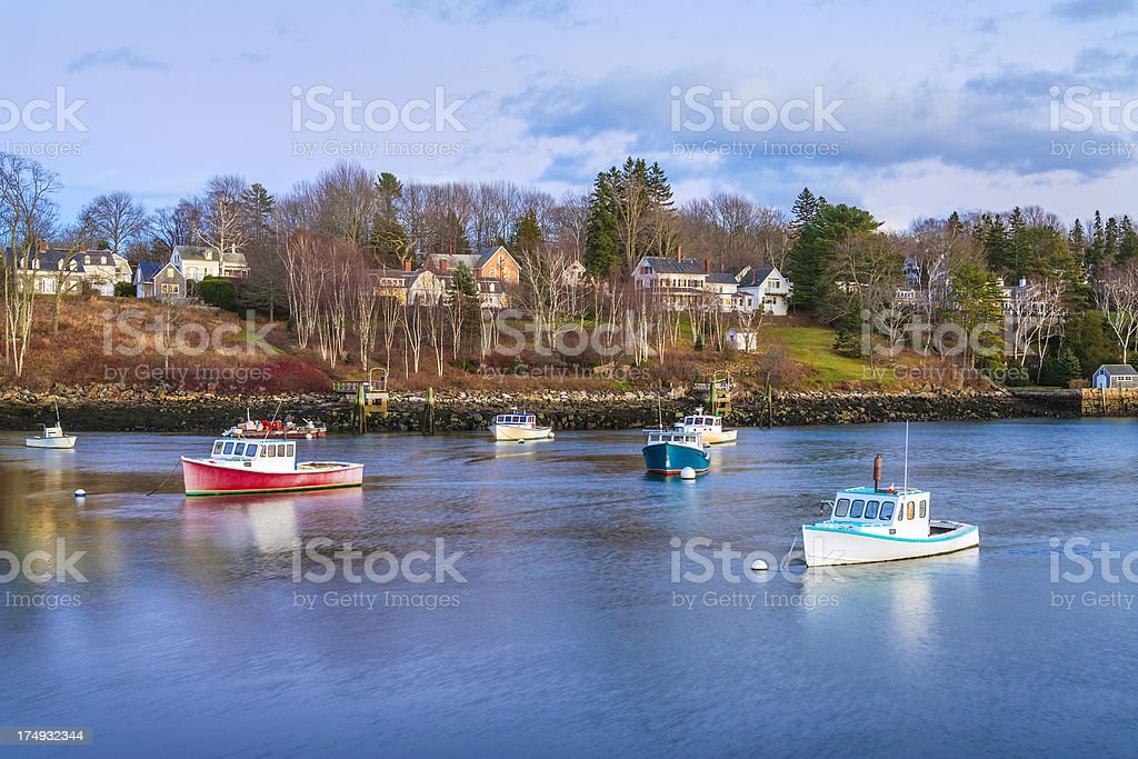 wintry New England fishing boats, harbor, and village stock photo