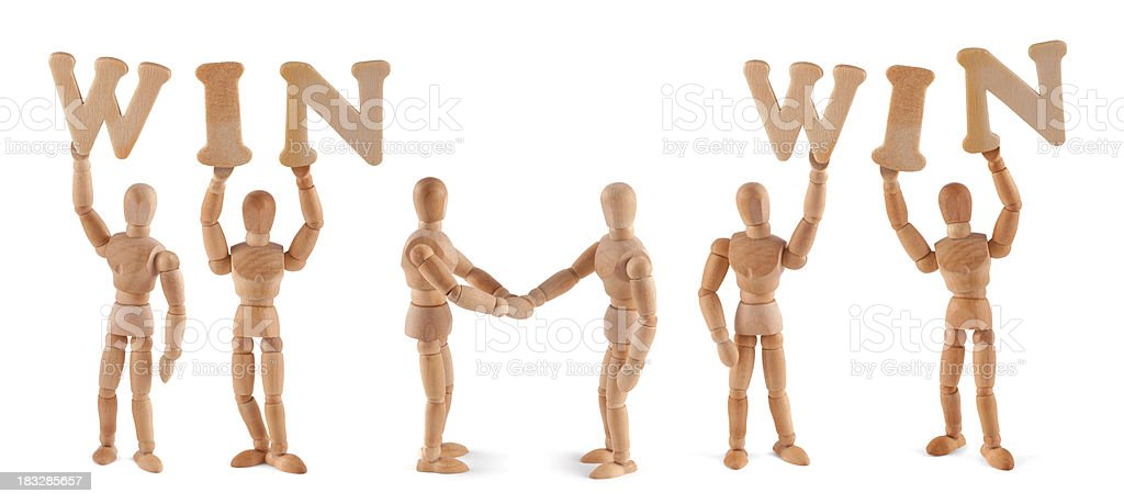 Win-Win Situation- wooden mannequin holding this word stock photo
