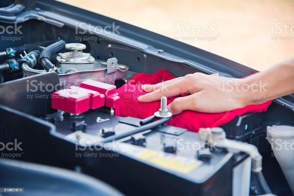 Wipe cleaning the car engine stock photo