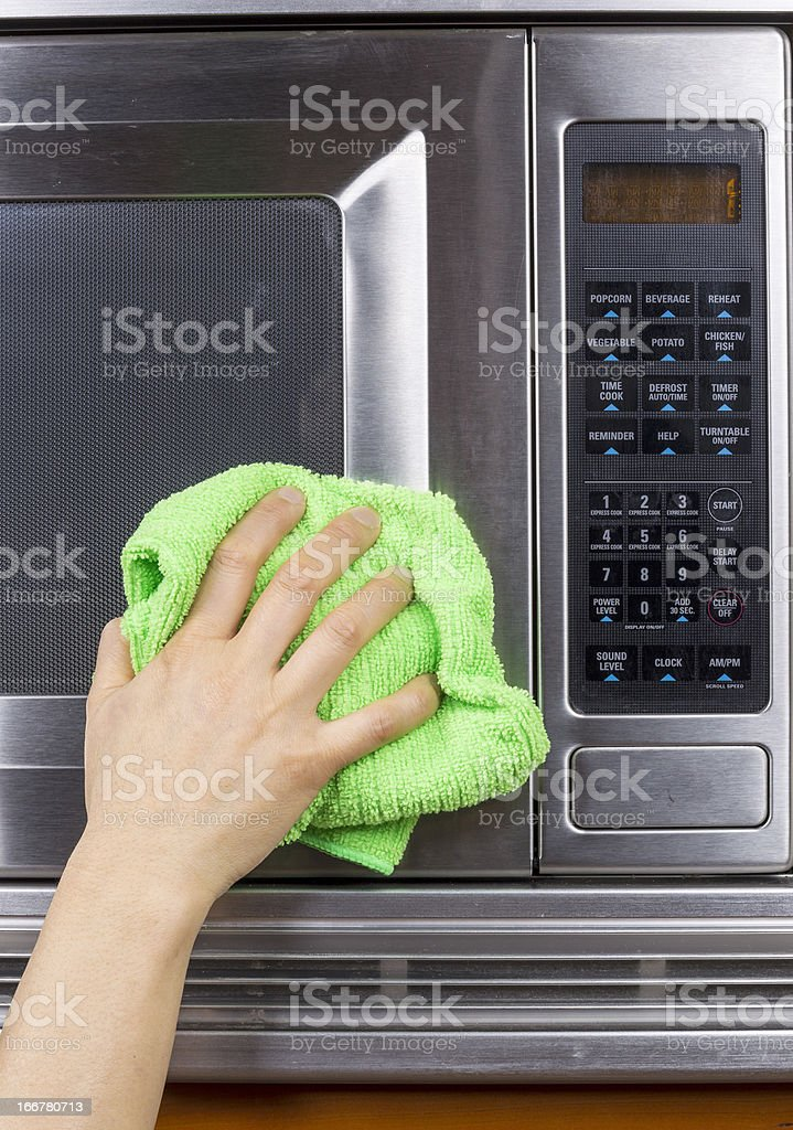 Wiping Down Kitchen Appliance royalty-free stock photo