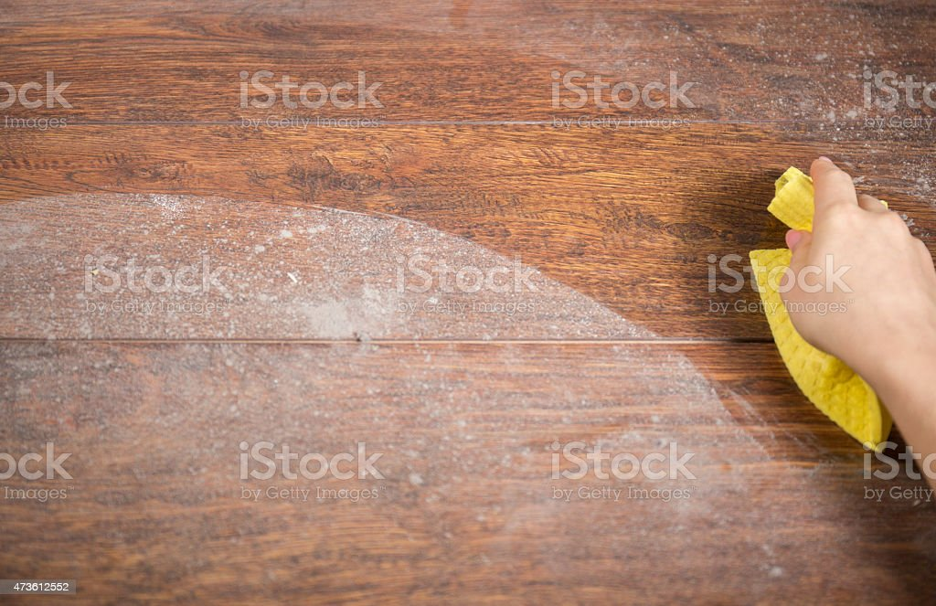 Wiping dusty wood using rag stock photo