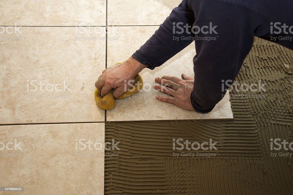 Wiping Grout stock photo