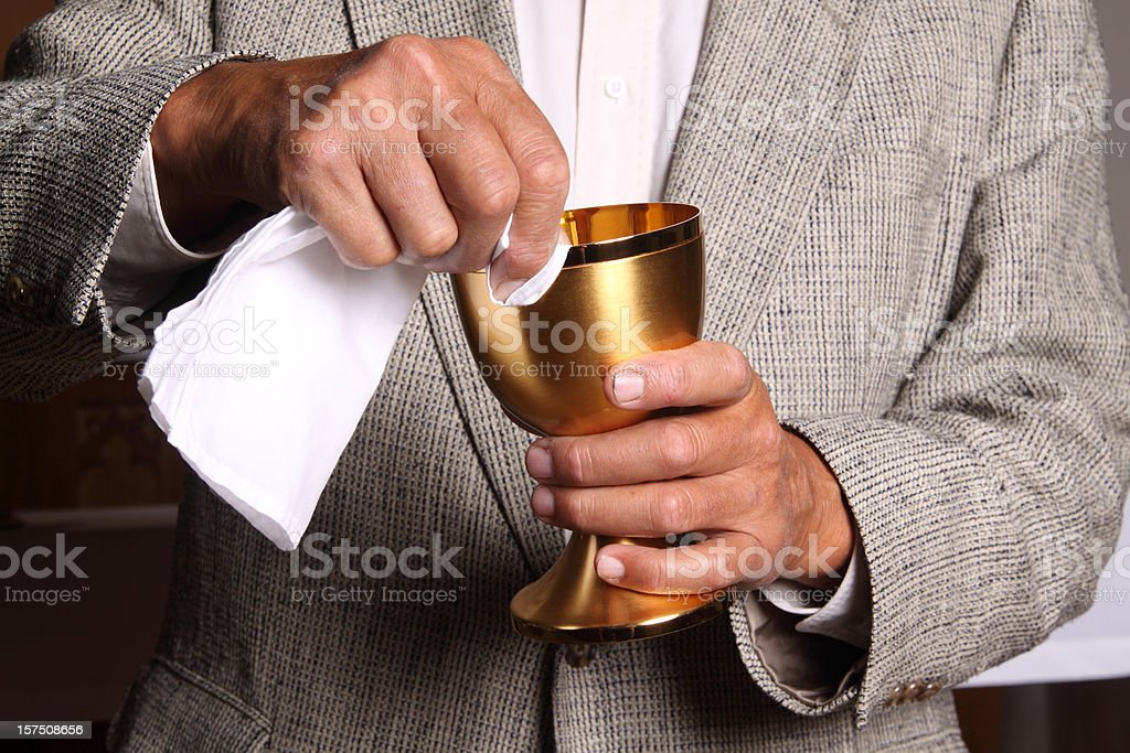 Wiping the Chalice stock photo