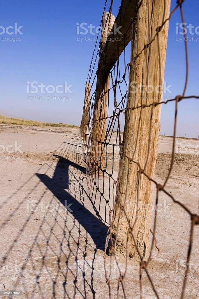 Wire and Wooden Fence Under Clear Skies stock photo