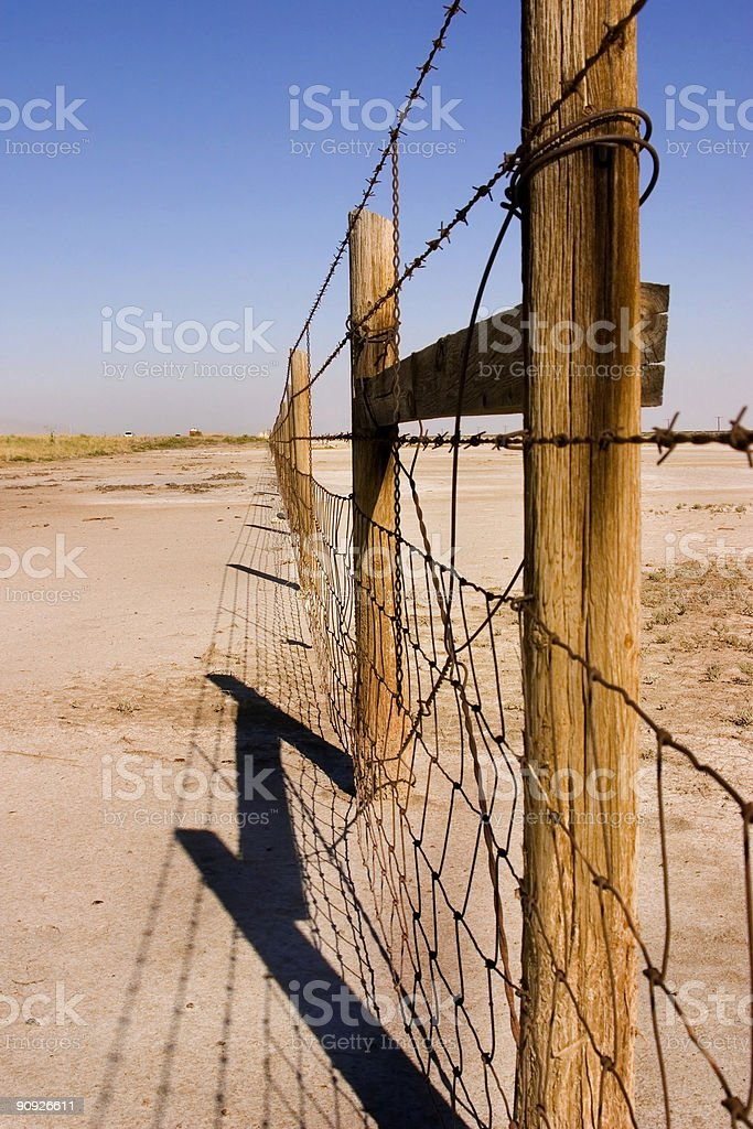 Wire and Wooden Fence Under Clear Skies royalty-free stock photo