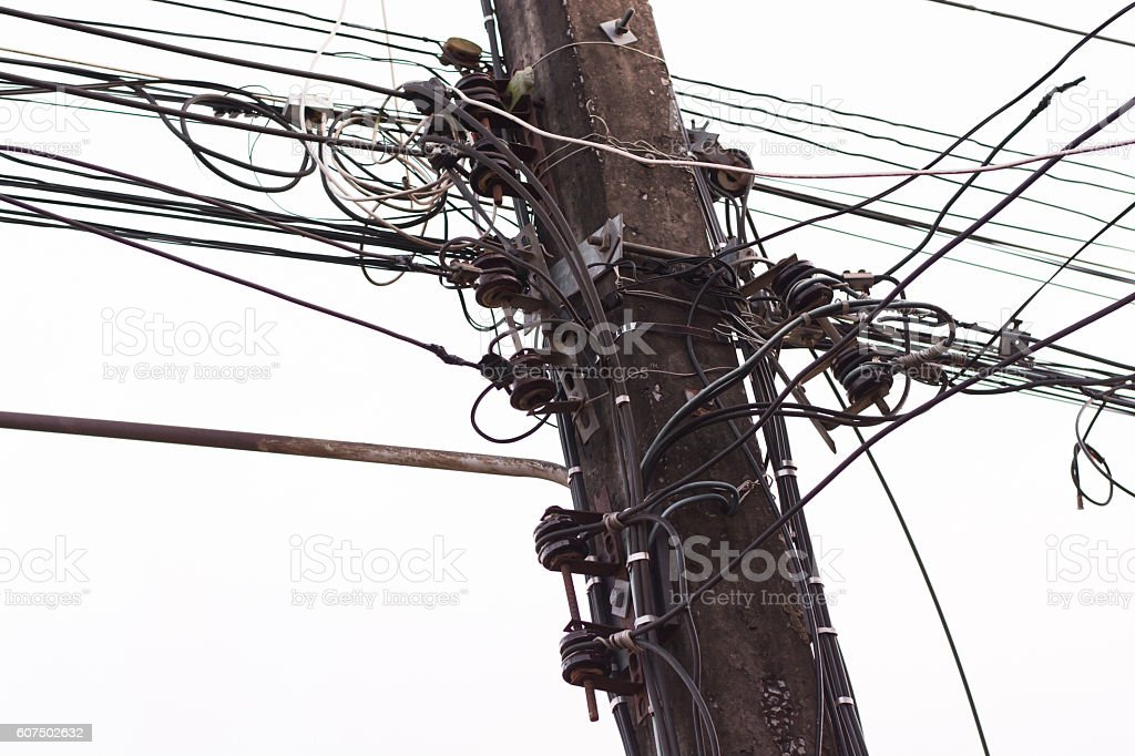 Wire assemblage a lot of cables and wires on pole stock photo