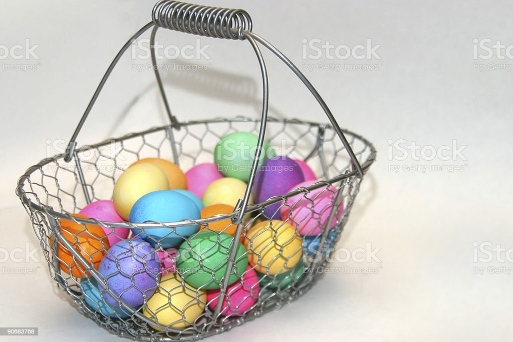 wire basket with colored eggs royalty-free stock photo