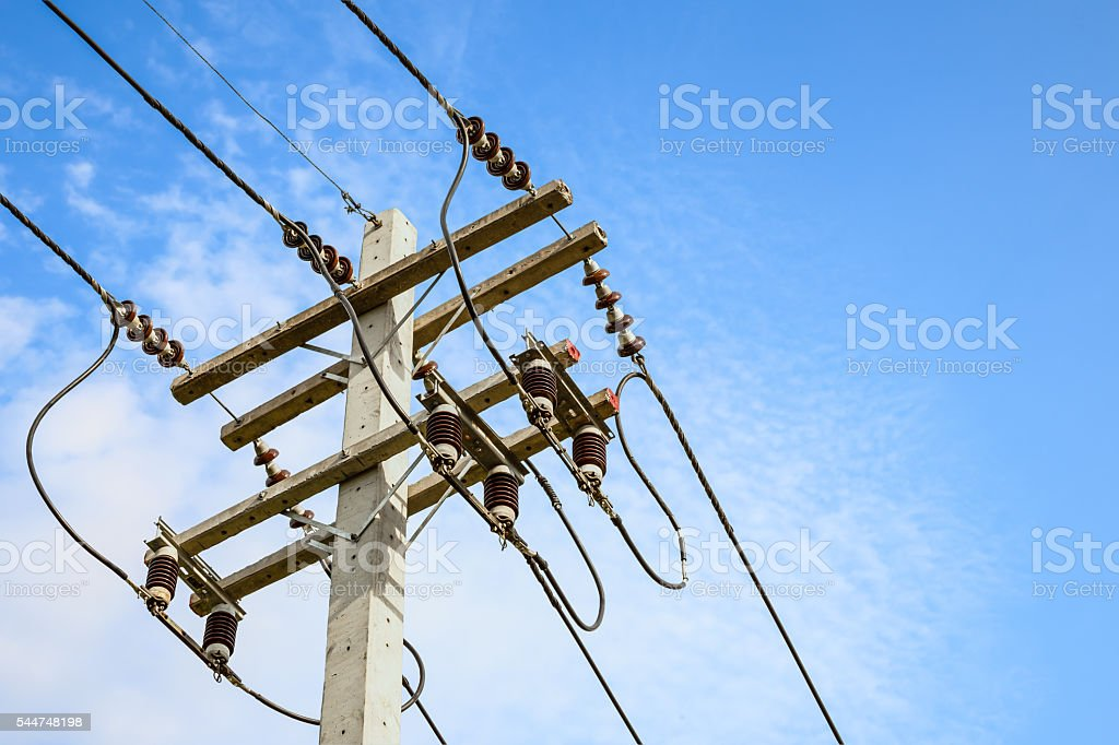 wire cables on electricity pole in the city for safety stock photo