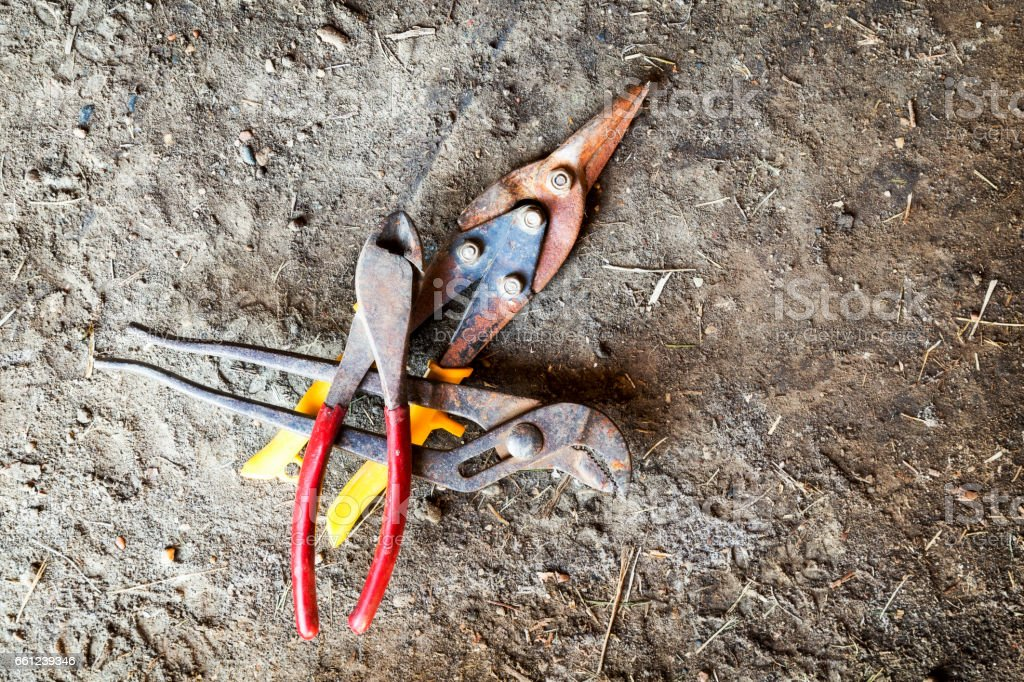 Wire Cutter, Tin Snips and Pliers on Ground stock photo