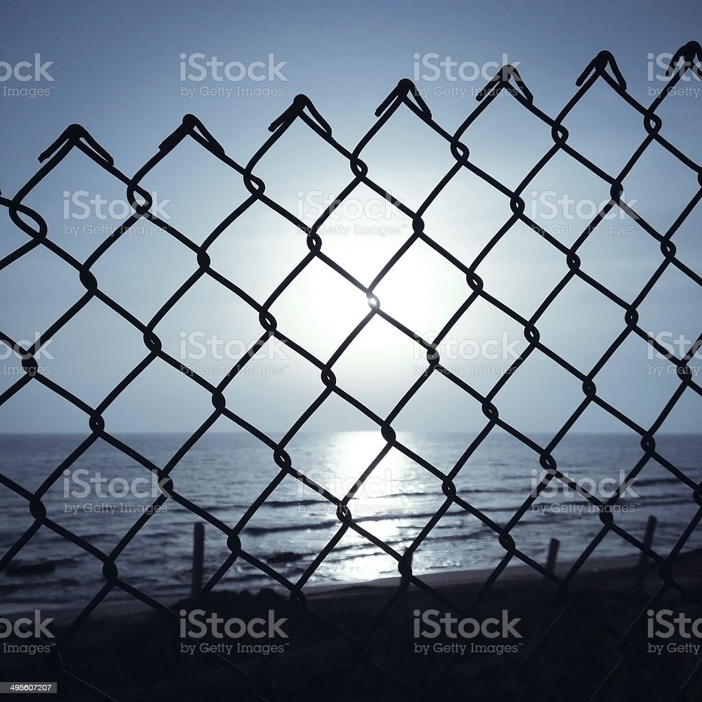 Wire fence next to the sea stock photo