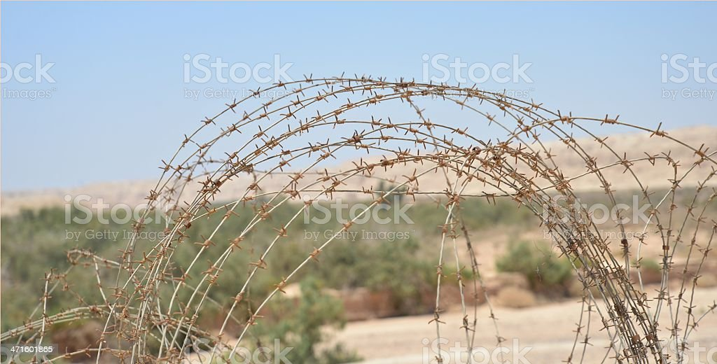Wire fence of mined fields in Arava Desert stock photo