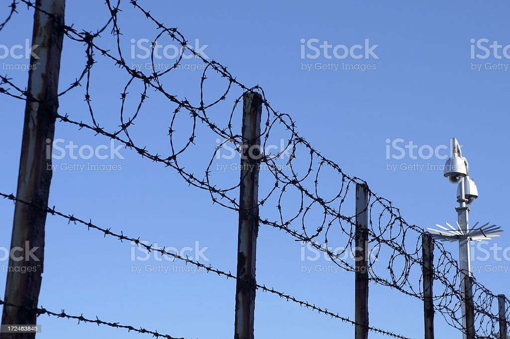 Wire Fence with Security Post stock photo