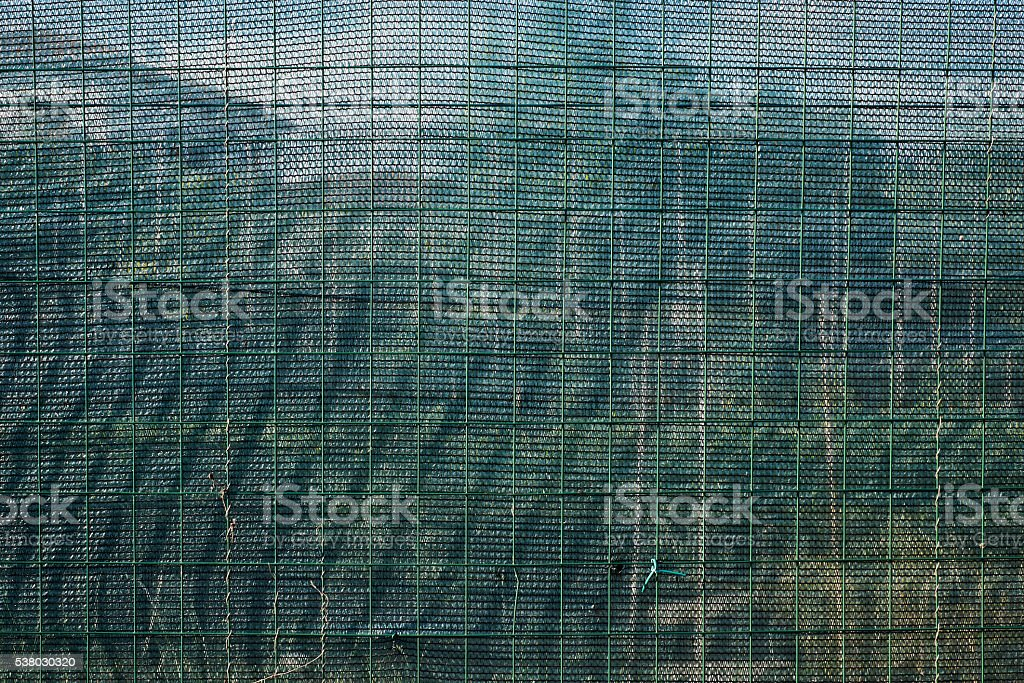 Wire mesh boundary surrounding the vegetable garden of a house stock photo