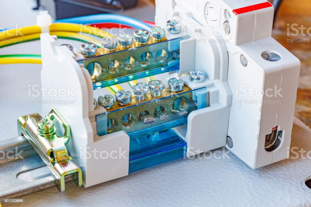 Wire terminal with automatic circuit breaker installed on a DIN-rail stock photo