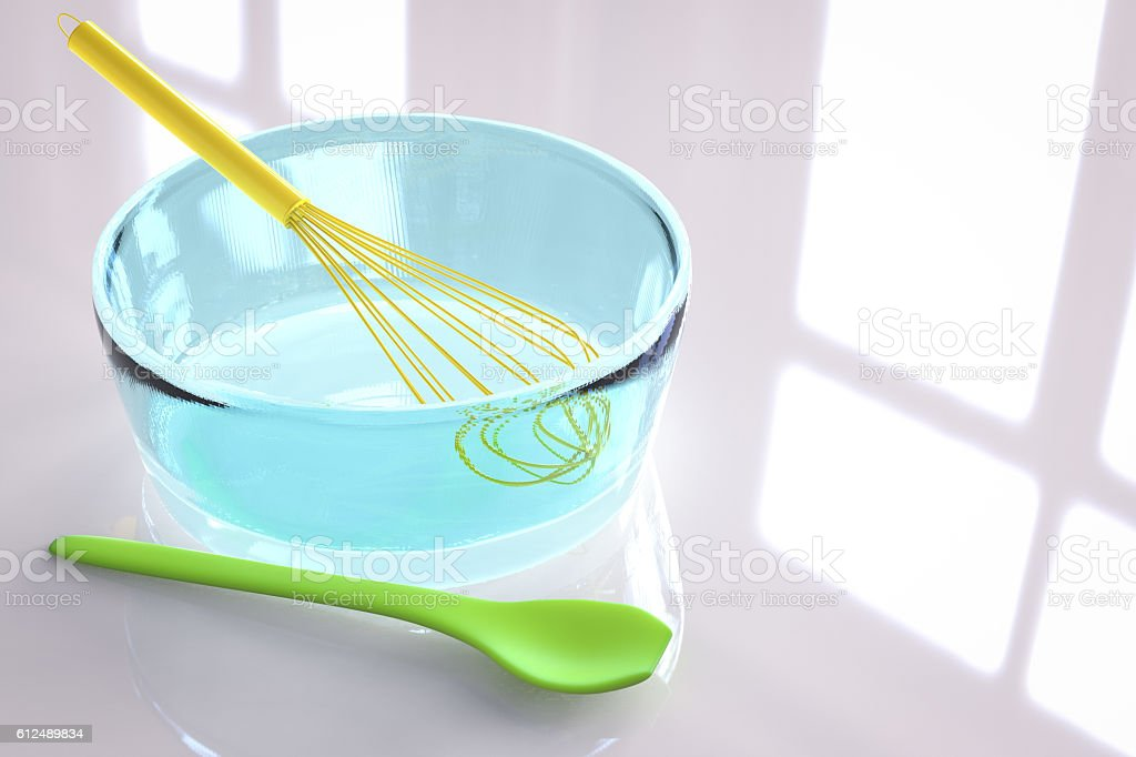 wire whisk in a bowl stock photo