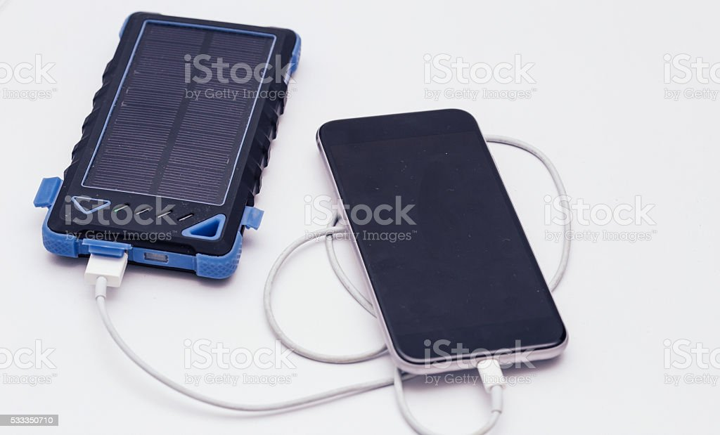 Wireless Battery Charger with a Smartphone stock photo