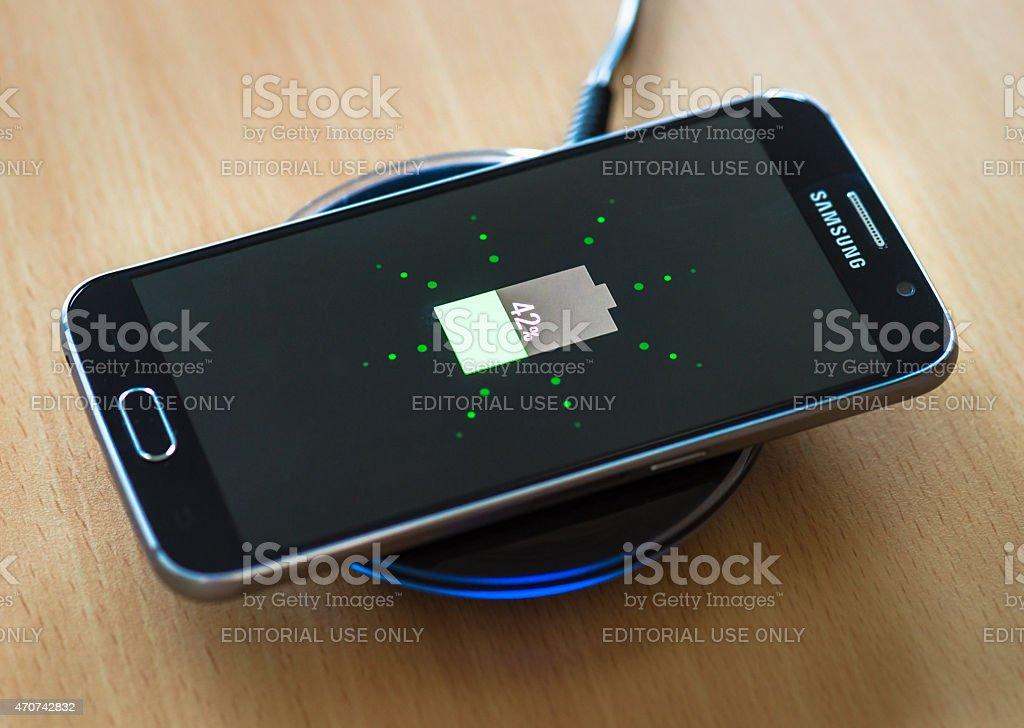 Wireless charging a Samsung Galaxy S6 smartphone stock photo