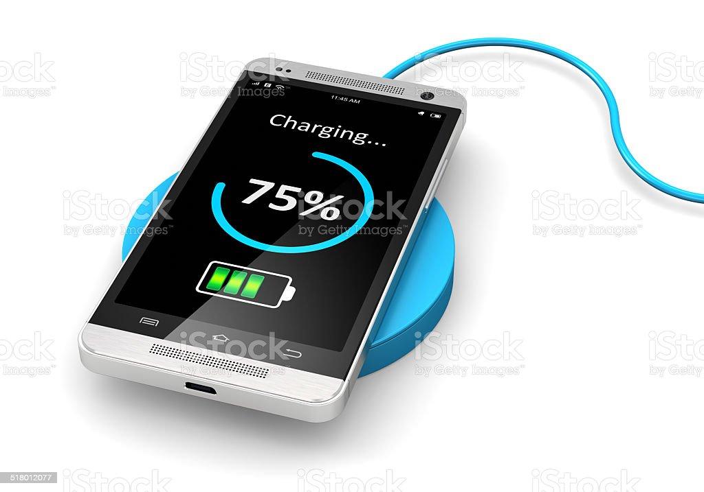 Wireless charging of smartphone stock photo