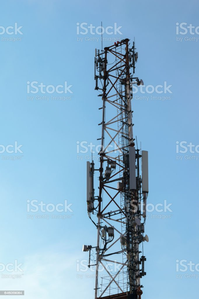 wireless comunication tower with antenna on clear sky stock photo